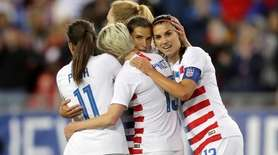 United States' Tobin Heath, second from right, is
