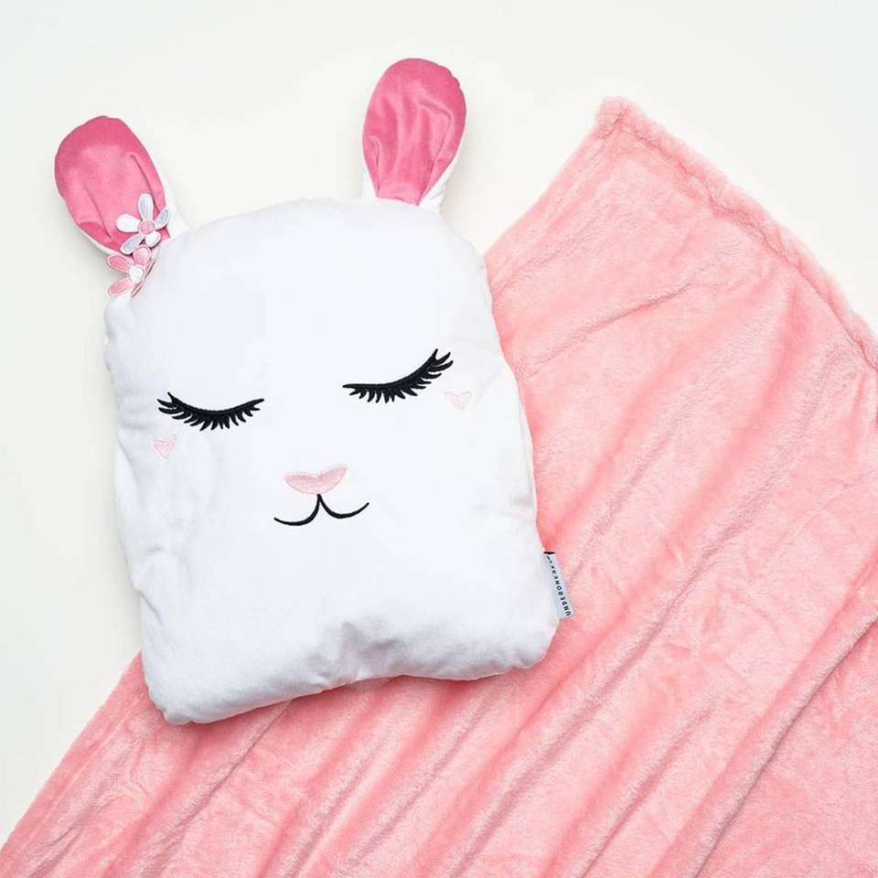 This adorable bunny pillow comes with a fuzzy