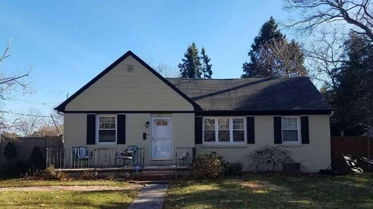 This East Patchogue ranch, for $320,000, includes three