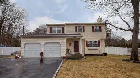 This East Patchogue Colonial, for $429,990, includes four