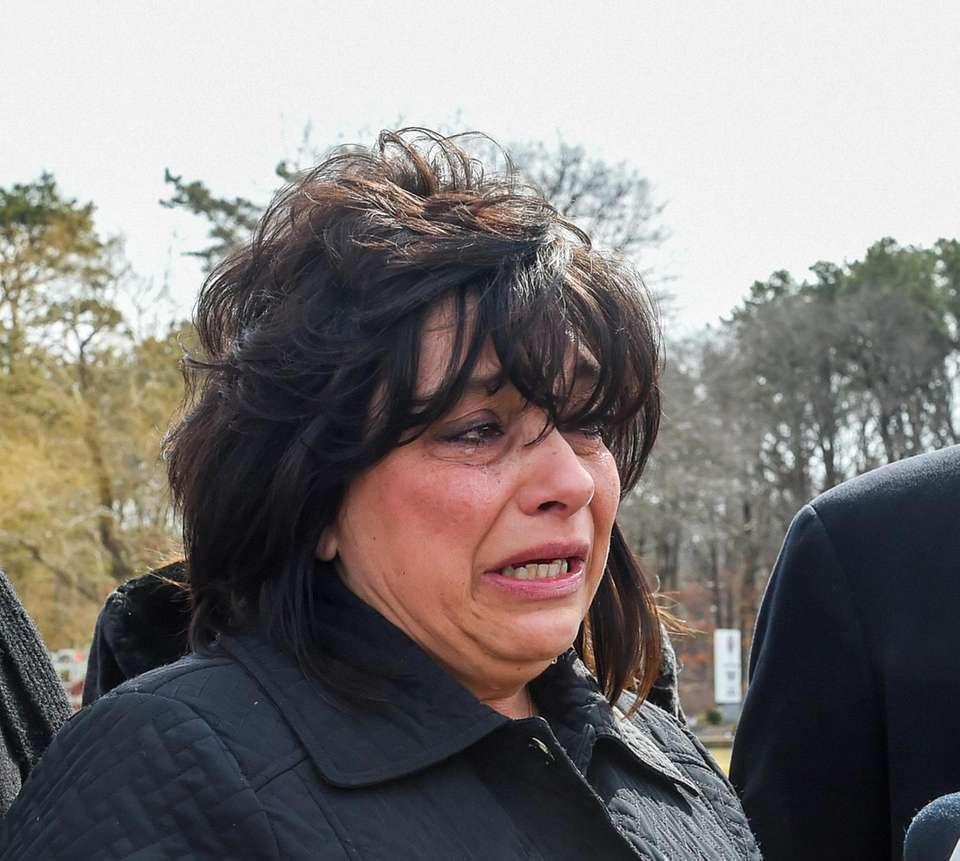Tears roll down Linda Mangano's face after she