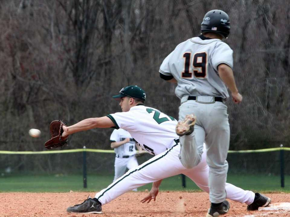 Lindenhurst first baseman Kenny Skon stretches to record