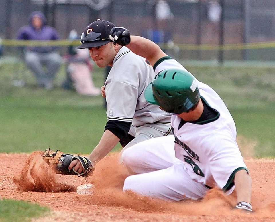 Lindenhurst's Steve Skon slides in ahead of the
