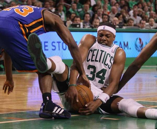 Boston's Paul Pierce fights for a loose ball