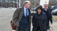 Attorney Kevin Keating, left, comforts Linda and Edward