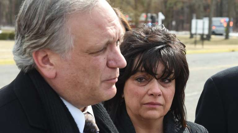 Tears remain on Linda Mangano's face as she
