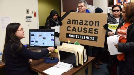 Protestors opposed to Amazon staged a demonstration outside
