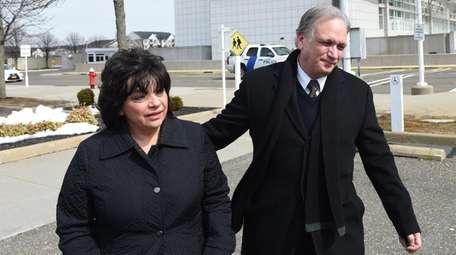 Ed and Linda Mangano leave federal court in