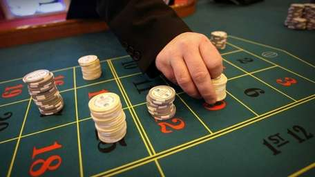 A file photo of a dealer placing chips