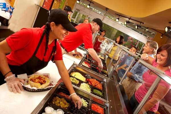 Moe's crew serving guests