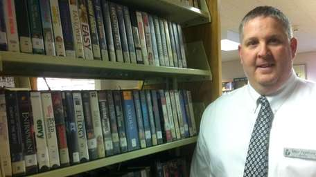 Bayport-Blue Point Library Director Mike Firestone stands in