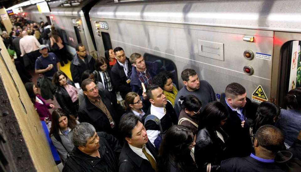 Passengers jam onto a train at Penn Station