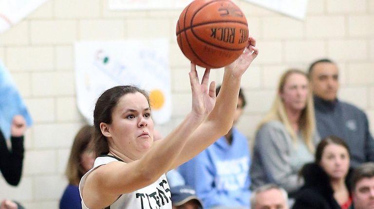 Holy Trinity's Natalie Stark shoots a three-pointer during