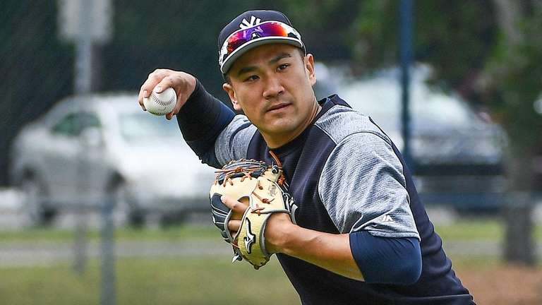 Yankees pitcher Masahiro Tanaka works out during spring