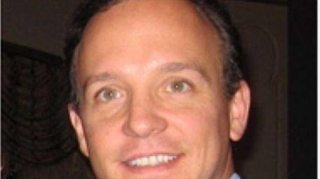 Tom Croci, 38, of Bohemia, is the Republican