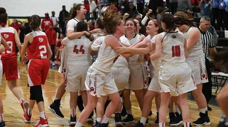 St. John the Baptist players celebrate their win
