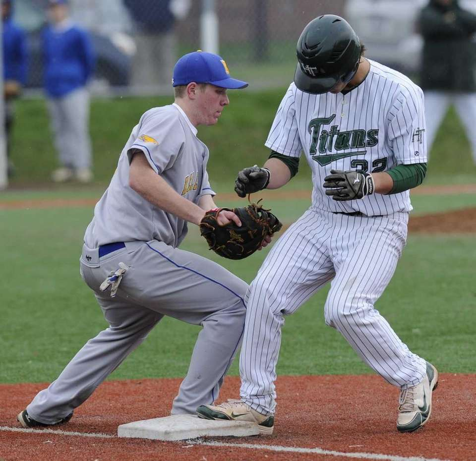Holy Trinity's Patrick Madigan is safe at first