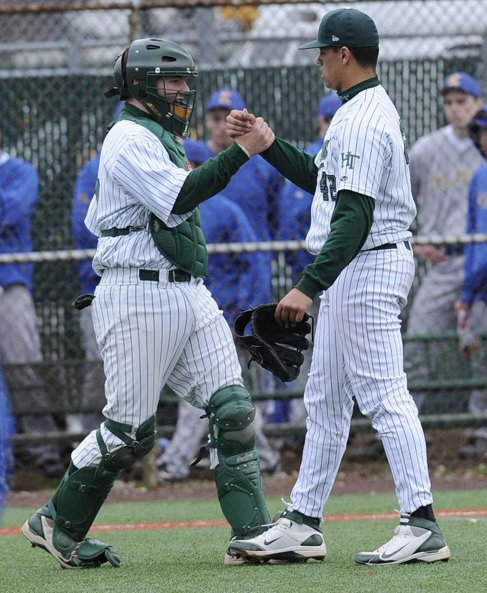 Holy Trinity pitcher Alexander Robinson, right, and catcher