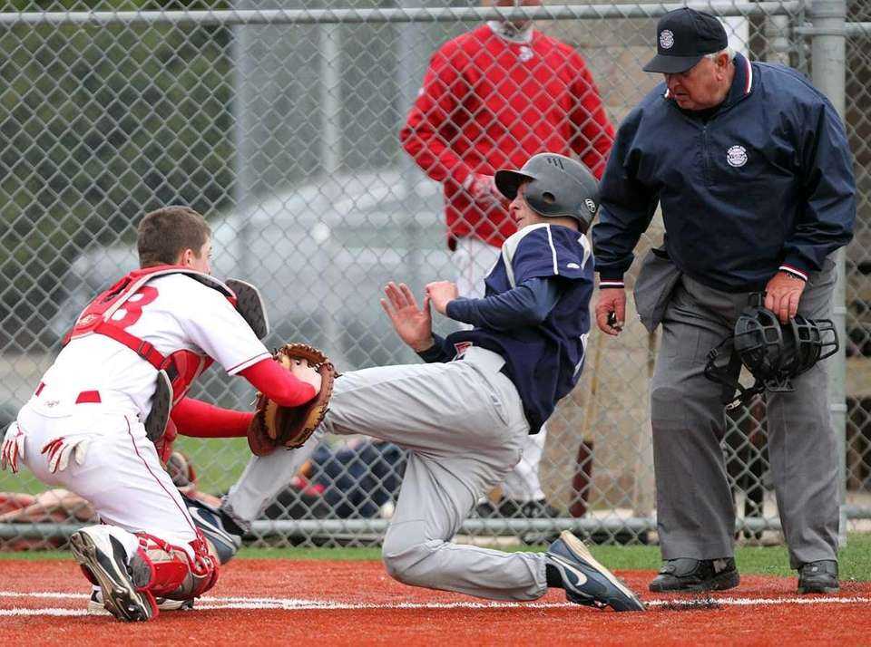 St. Dominic Nick Girardi (4) is tagged out