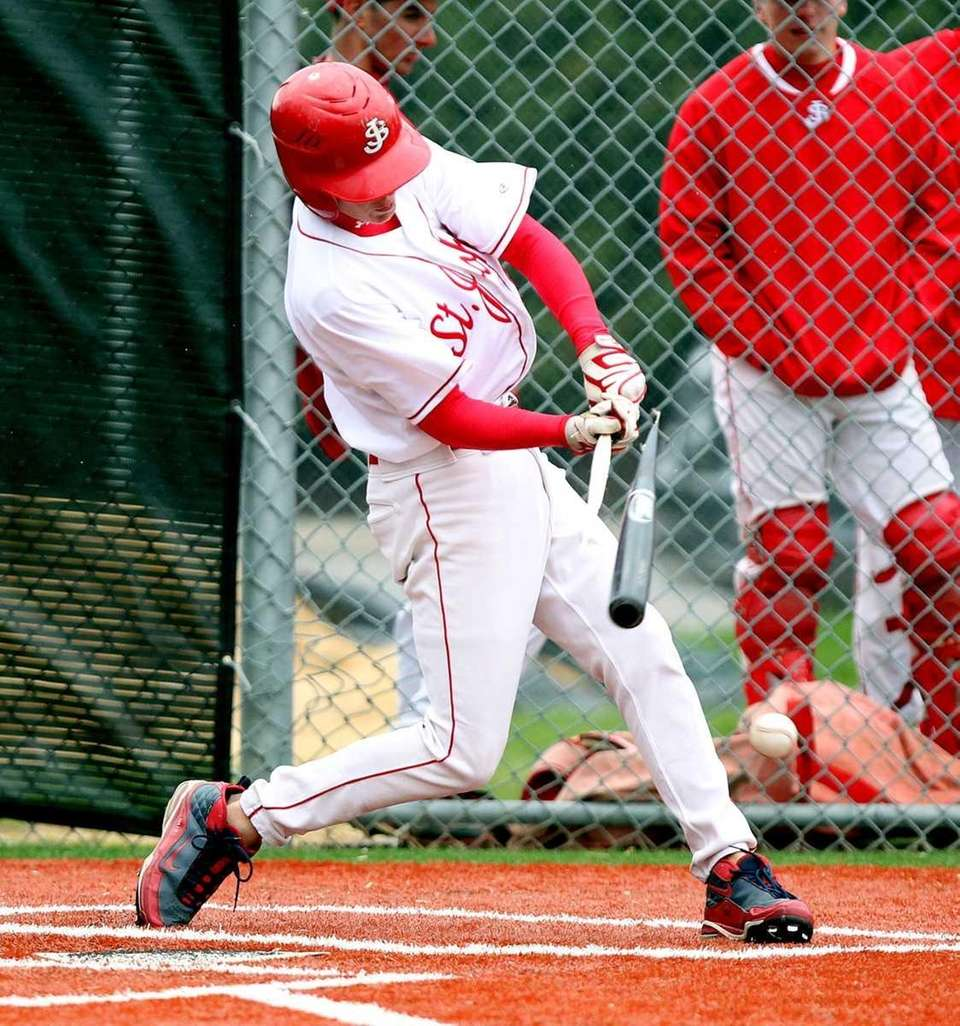St John's Kyle Collins (6) breaks his bat