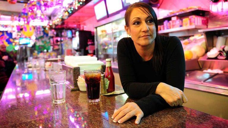 Theresa Borgesano behind the counter at the Oconee