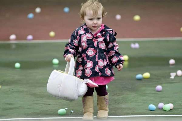 15-month-old Hailey Ward of Huntington collecting plastic treasures