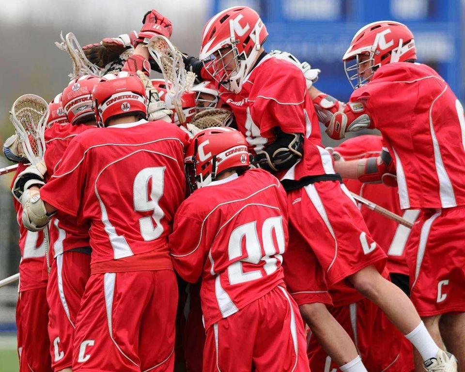 Connetquot High School varsity boys lacrosse teammates mob