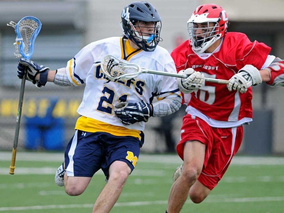 Massapequa High School #21 Daniel Muller, left, gets