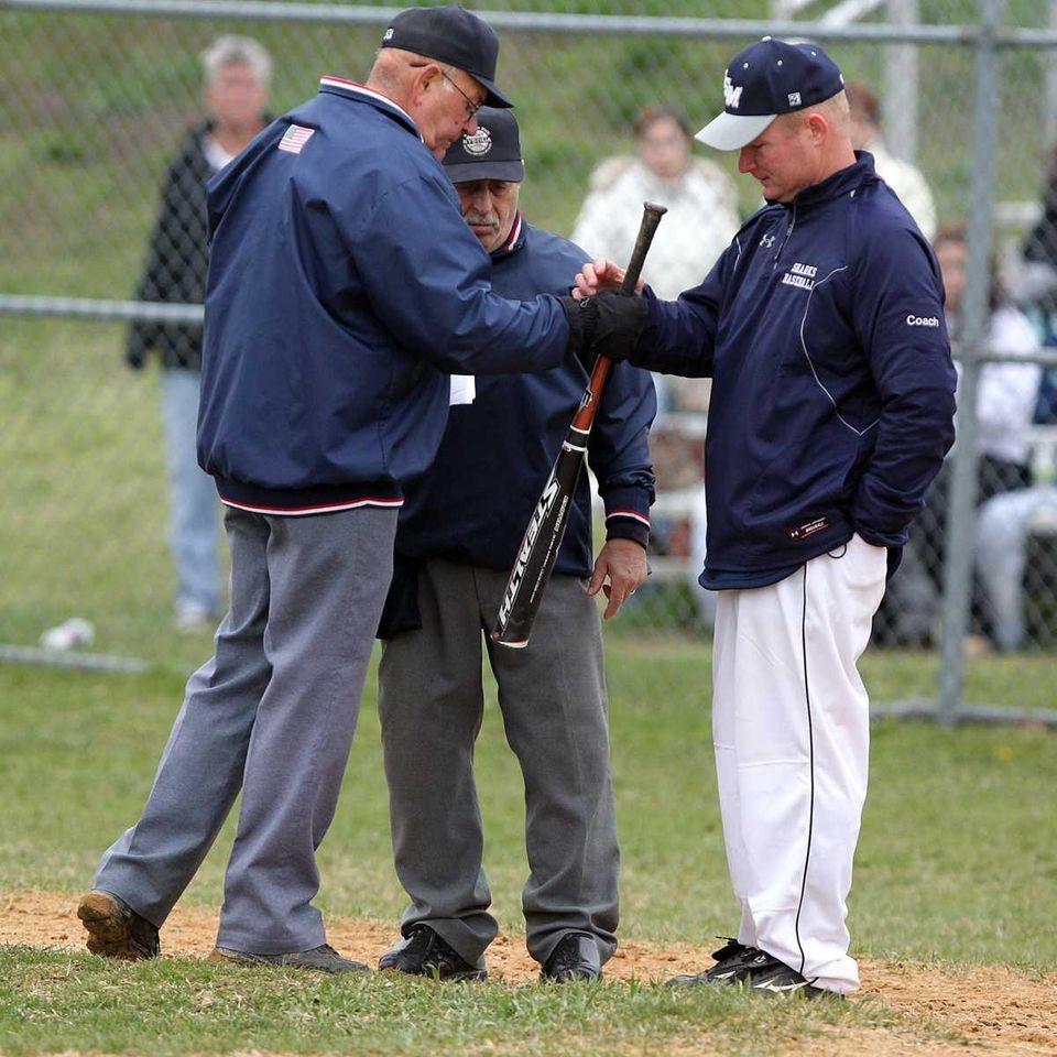 Eastport-South Manor head coach Todd Skala, right,