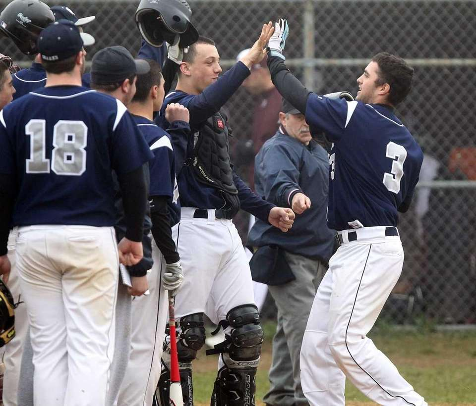 Eastport's Mat Annunziata, right, celebrates with teammates at
