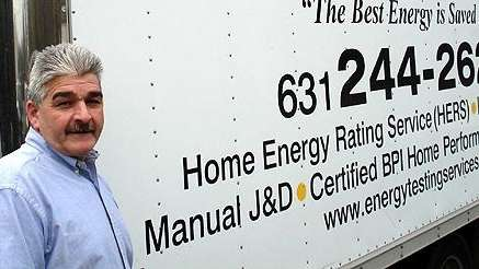 Robert Delfino with an Energy Testing Services truck.