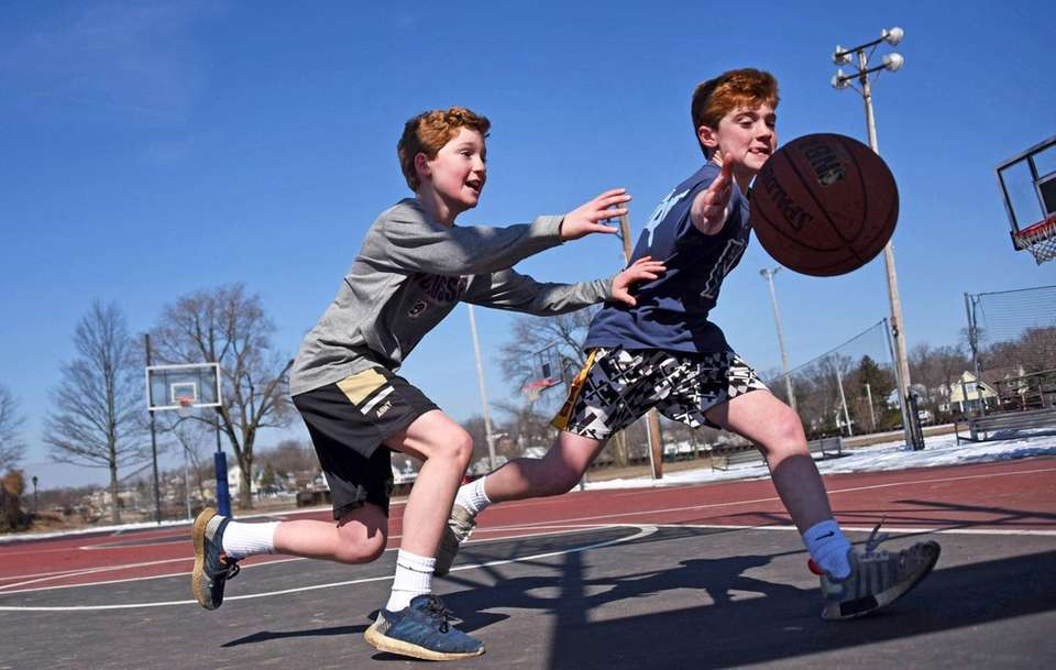 Eleven-year-old twins Liam, left, and Tommy McCarvill of