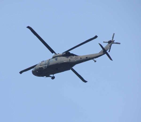 A Black Hawk helicopter flies above Ocean Parkway.