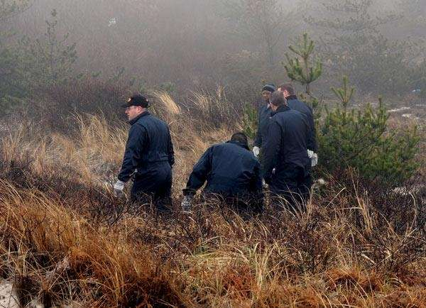 State Police search brush near Field 6 at
