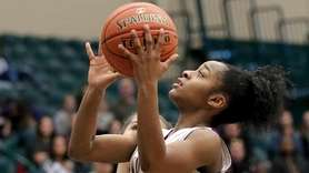 Sewanhaka's Flo Hunte moves in for two points
