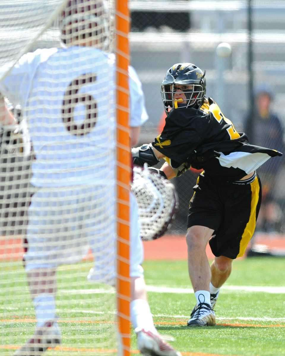 Wantagh's John Ingrilli, right, challenges Garden City goalkeeper