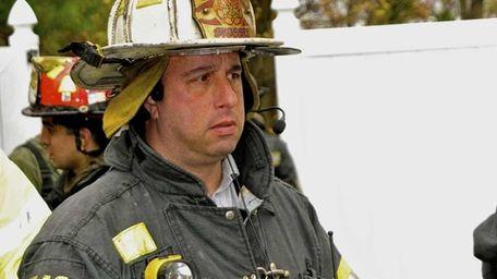 New Syosset Fire Department Chief Robert Kaplan listens