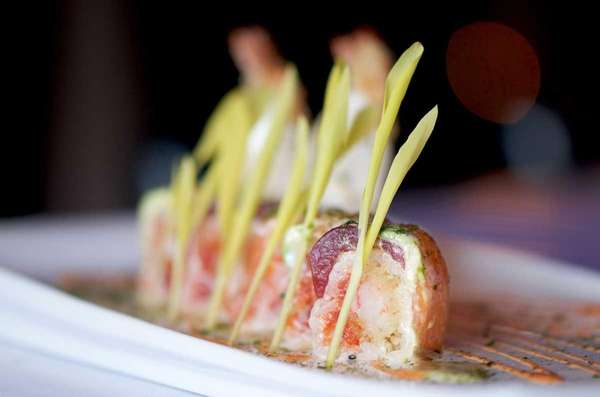 Signature sushi rolls are creatively plated at Kashi,
