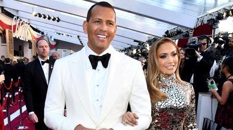 Alex Rodriguez and Jennifer Lopez attend the Oscars