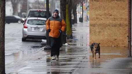 Frank Porfido, of Patchogue, runs with his dog