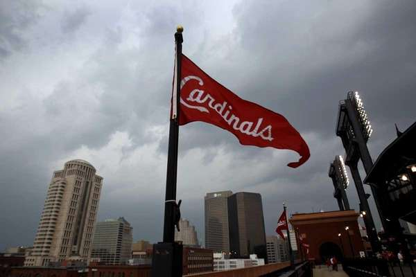 A St. Louis Cardinals banner blows in the