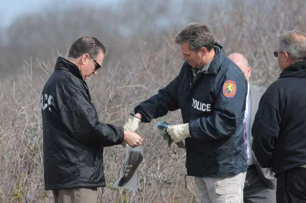 Police recover a shoe where a skull had