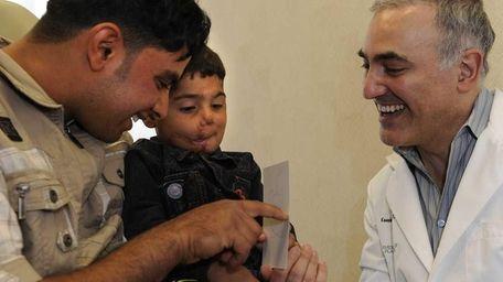 Zeenabdeen Hadi, with his uncle Hasan Khazaal, has