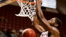 Hofstra's Jacquil Taylor dunks against James Madison at
