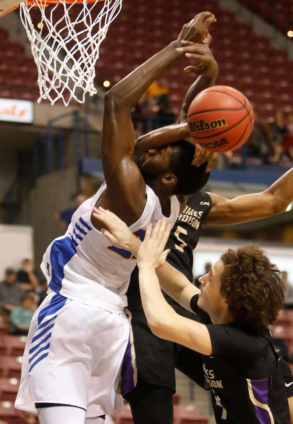 Hofstra's Jacquil Taylor, at left, gets fouled across