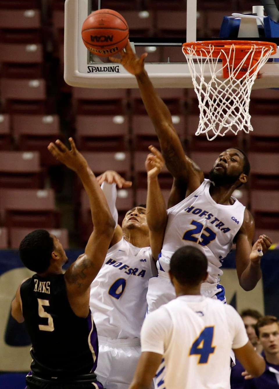 Hofstra's Jacquil Taylor (23) blocks the shot of