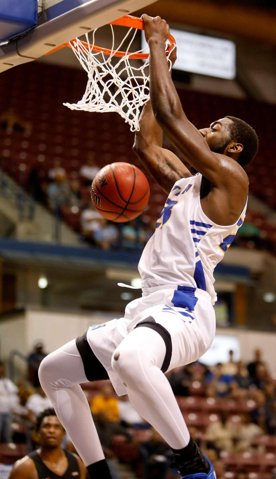 Hofstra's Jacquil Taylor dunks the ball against against