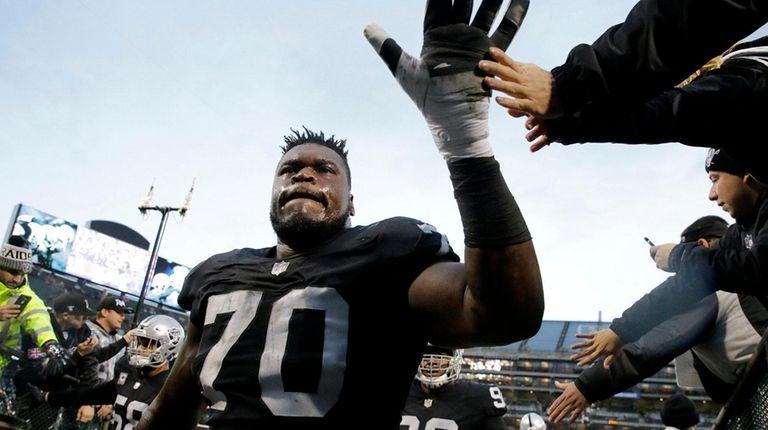 Oakland Raiders offensive tackle Kelechi Osemele (70) greets