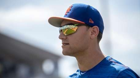 Mets outfielder Michael Conforto looks on during a