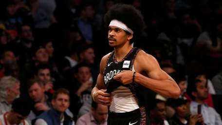 Jarrett Allen #31 of the Nets walks off